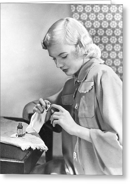 Woman Taking Care Of Her Nails Greeting Card by Underwood Archives