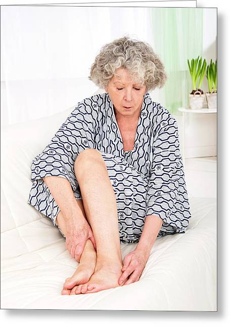 Woman Touching Her Ankle Greeting Card by Lea Paterson