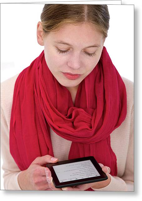 Woman Using E-reader Greeting Card by Lea Paterson