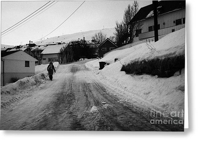 Scandanavian Greeting Cards - woman walking down steep ice covered street in Honningsvag finnmark norway europe Greeting Card by Joe Fox