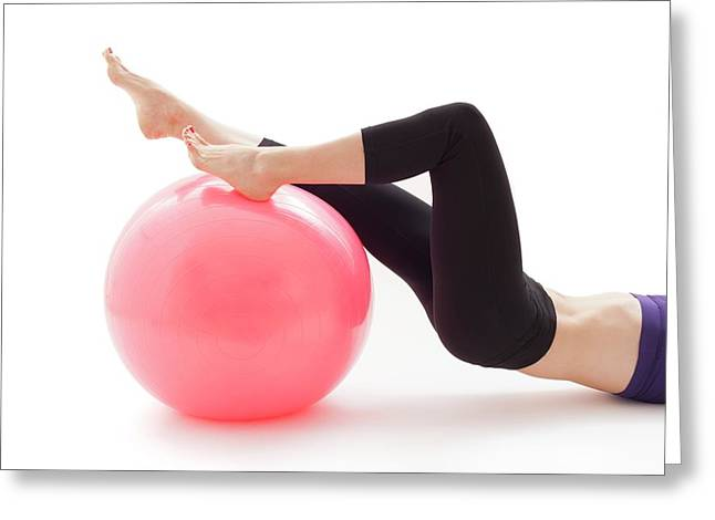 Woman With Fitness Ball Greeting Card by Ian Hooton