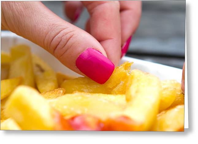 French Fries Greeting Cards - Woman With Pink Nails Eating Chips Greeting Card by Fizzy Image