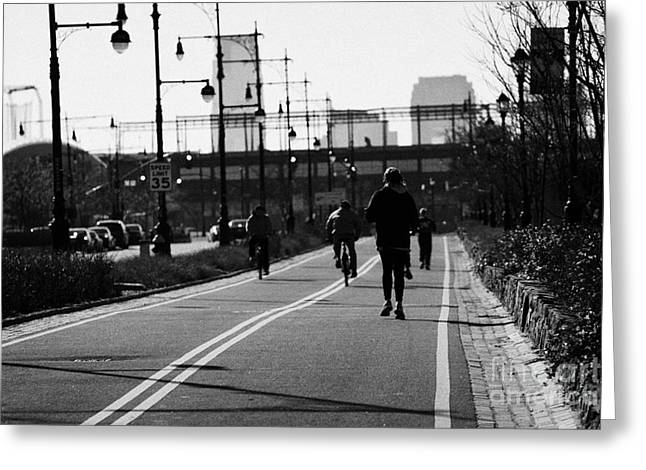 Wellbeing Greeting Cards - women running and men cycling exercising on bikeway next to West Side Highway new york Greeting Card by Joe Fox