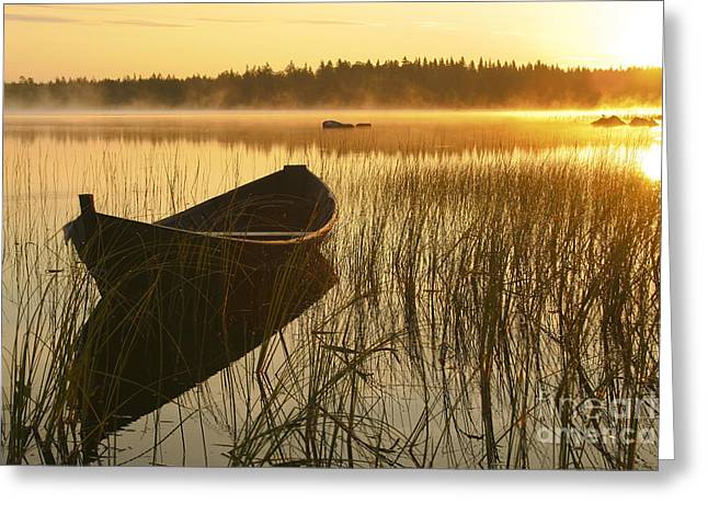 Sunrise. Water Greeting Cards - Wooden boat Greeting Card by Veikko Suikkanen