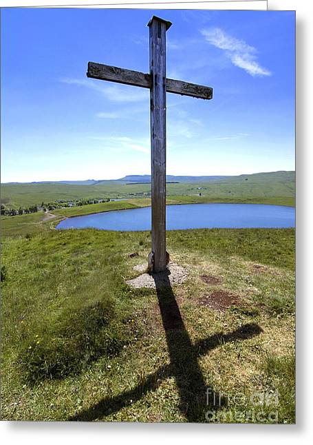 The Wooden Cross Greeting Cards - Wooden cross overlooking Lake Godivelle. Puy de Dome. Auvergne. France Greeting Card by Bernard Jaubert