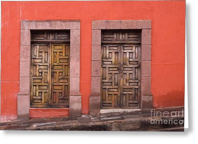 Entrance Door Greeting Cards - Wooden Doors on Orange Wall Greeting Card by Oscar Gutierrez