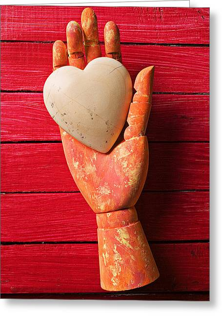 Hand-held Greeting Cards - Wooden hand with white heart Greeting Card by Garry Gay