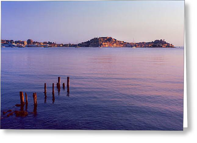 Wooden Posts In Sea, Portoferraio Greeting Card by Panoramic Images