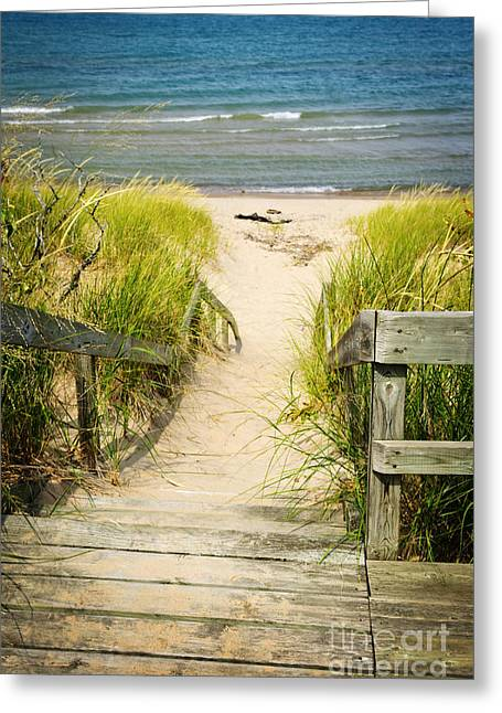 Peaceful Scenery Greeting Cards - Wooden stairs over dunes at beach Greeting Card by Elena Elisseeva