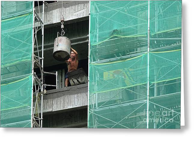 Netting Greeting Cards - Worker at a Construction Site Unloads Cement Greeting Card by Yali Shi