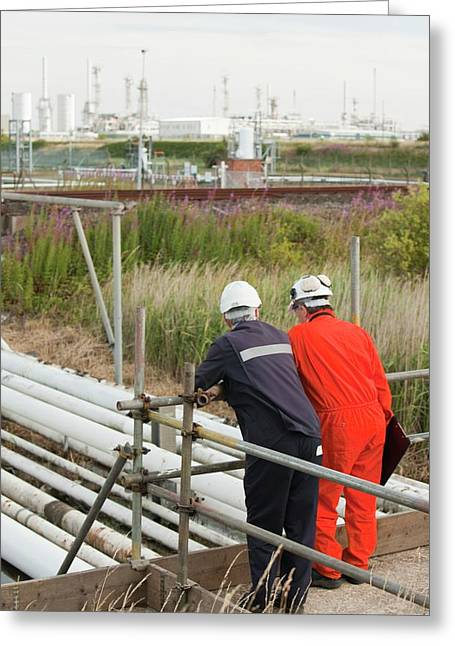 Workman Inspect A Pipeline Greeting Card by Ashley Cooper