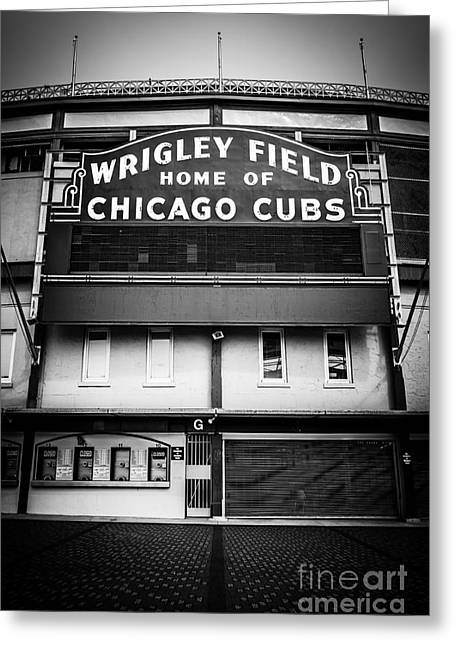 Buildings Greeting Cards - Wrigley Field Chicago Cubs Sign in Black and White Greeting Card by Paul Velgos