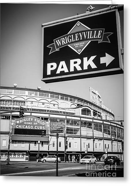 Chicago Cubs Stadium Greeting Cards - Wrigleyville Sign and Wrigley Field in Black and White Greeting Card by Paul Velgos