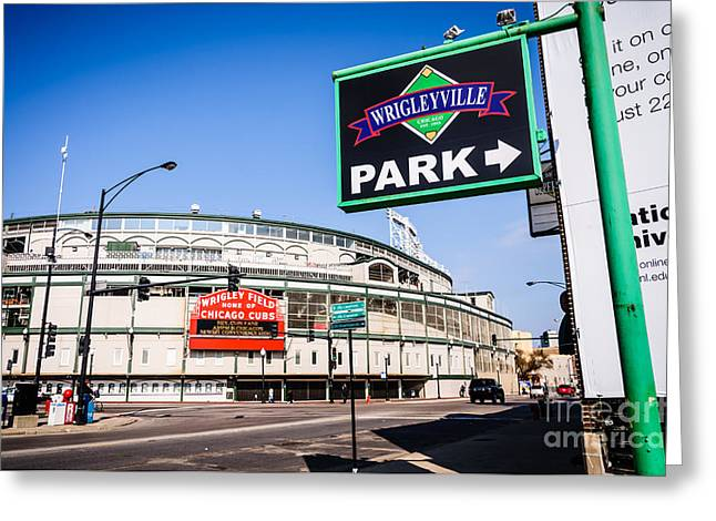 Chicago Cubs Stadium Greeting Cards - Wrigleyville Sign and Wrigley Field in Chicago Greeting Card by Paul Velgos