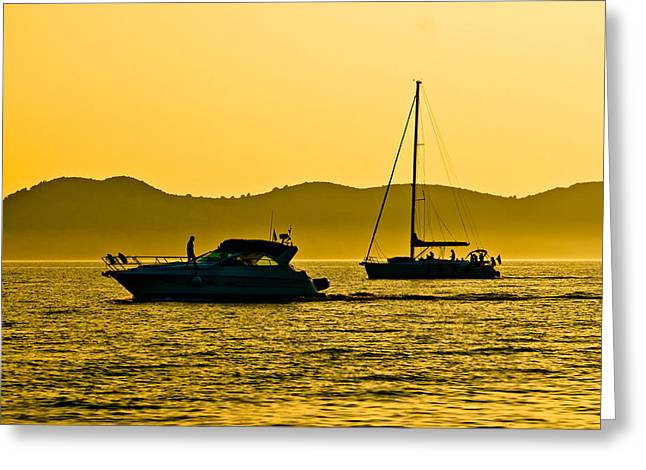 Yellow Sailboats Greeting Cards - Yacht and sailboat silhouette at golden sunset Greeting Card by Dalibor Brlek