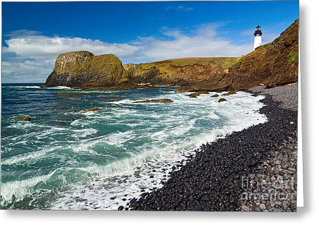 Spectacular Ocean Vistas Greeting Cards - Yaquina Lighthouse on top of rocky beach Greeting Card by Jamie Pham