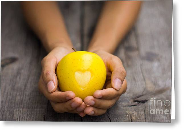 Produce Greeting Cards - Yellow Apple with engraved heart Greeting Card by Aged Pixel