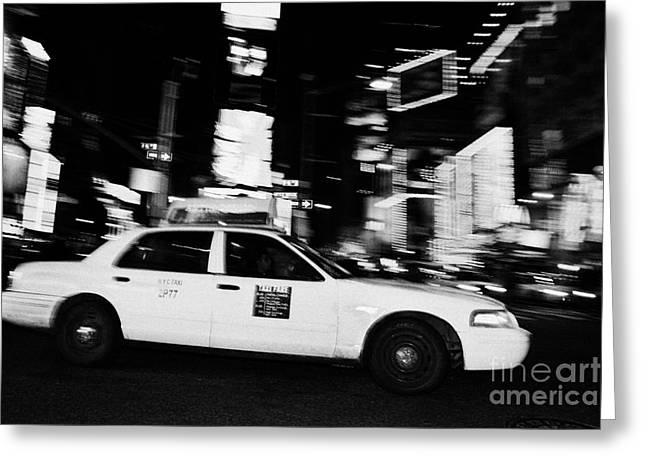 Yellow Cab At Speed In The Middle Of Times Square New York City At Night Greeting Card by Joe Fox