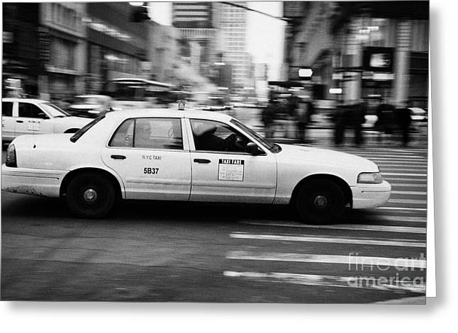 Manhaten Greeting Cards - Yellow Cab Blurring Past Crosswalk And Pedestrians New York City Usa Greeting Card by Joe Fox