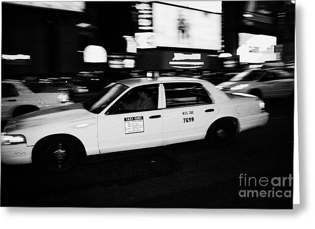 Manhaten Greeting Cards - Yellow Cab In Times Square At Night New York City Greeting Card by Joe Fox