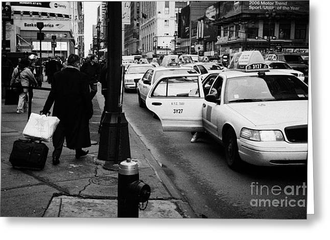 Manhaten Greeting Cards - Yellow Cab On Taxi Rank Outside Madison Square Garden On 7th Avenue New York City Usa Greeting Card by Joe Fox