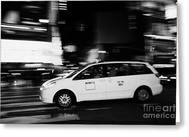 Yellow Cab Speeding Across Crosswalk In Times Square At Night New York City Greeting Card by Joe Fox