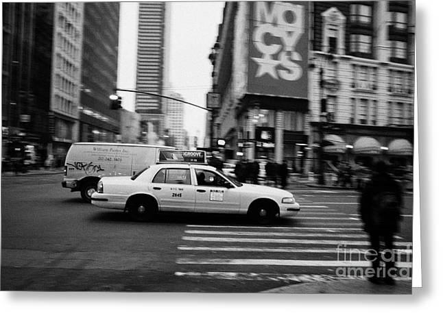 yellow cab taxi blurs past pedestrian waiting at crosswalk on Broadway outside macys new york usa Greeting Card by Joe Fox