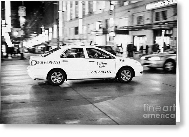 Speeding Taxi Greeting Cards - yellow cab taxi crossing junction downtown Vancouver city at night BC Canada deliberate motion blur Greeting Card by Joe Fox