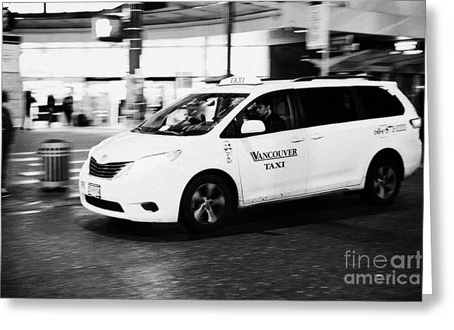 North Vancouver Greeting Cards - yellow cab taxi downtown Vancouver city shopping area at night BC Canada deliberate motion blur Greeting Card by Joe Fox