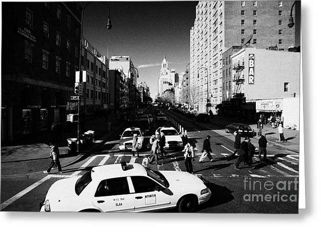 Manhaten Greeting Cards - yellow cabs and pedestrians on crosswalk at junction of 1st Avenue and east 14th street st new york Greeting Card by Joe Fox