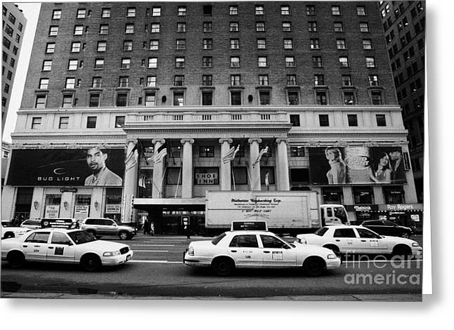 Manhaten Greeting Cards - Yellow Cabs Go Past Pennsylvania Hotel On 7th Avenue New York City Usa Greeting Card by Joe Fox
