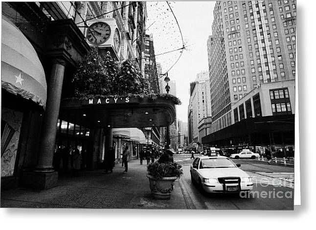 yellow taxi cab waits outside entrance to Macys department store on Broadway and 34th street Greeting Card by Joe Fox