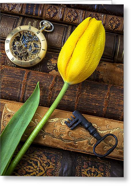 Pocketwatches Greeting Cards - Yellow tulip on old books Greeting Card by Garry Gay