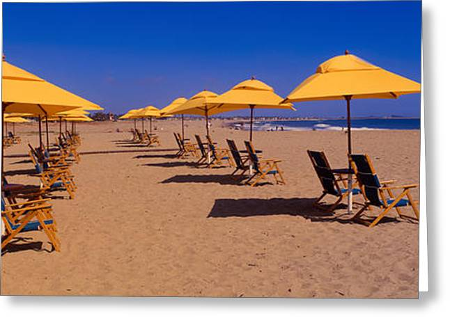 Ocean Shore Greeting Cards - Yellow Umbrellas And Beach Chairs Greeting Card by Panoramic Images