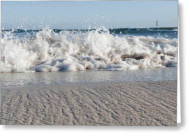 Clear Shoes Greeting Cards - A close up of a mediterranean wave in Punta Prima beach with the lighthouse - Yes I got wet shoes Greeting Card by Pedro Cardona