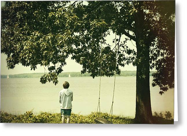 Young boy looking out at the water under a big tree Greeting Card by Sandra Cunningham