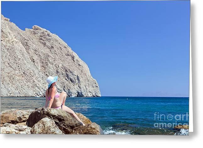 Sunbathing Greeting Cards - Young brunette beautiful woman sunbathing on rock on tropical beach Greeting Card by Michal Bednarek