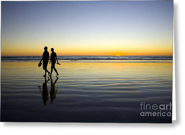Couples Photographs Greeting Cards - Young Couple Walking on Romantic Beach at Sunset Greeting Card by Colin and Linda McKie