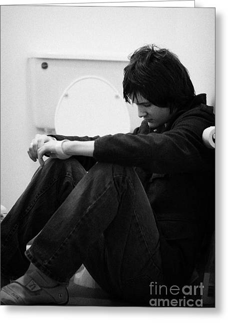 Concern Greeting Cards - Young Dark Haired Teenage Man Sitting On The Floor Of The Bathroom With Back Against The Wall In The Greeting Card by Joe Fox