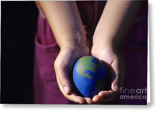 Emotional Knowledge Greeting Cards - Young girl holding earth egg Greeting Card by Jim Corwin