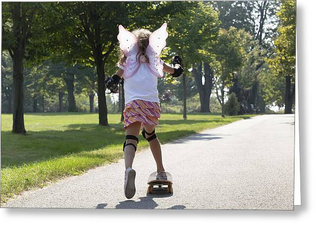 Full Skirt Greeting Cards - Young Girl Skateboarding While Wearing Greeting Card by Mary Ellen McQuay