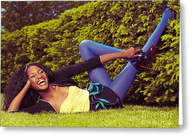 Legs Up Greeting Cards - Young Happy Black Woman Lying on the Grass Greeting Card by Oleksiy Maksymenko
