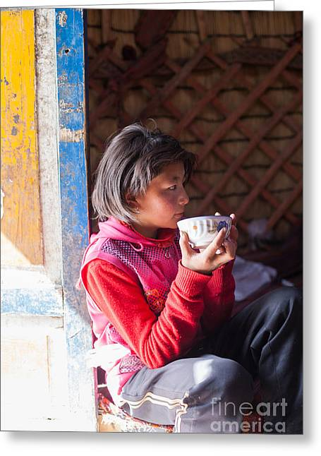 Ethnical Greeting Cards - Young kyrgyz girl drinking tea inside a yurt China Greeting Card by Matteo Colombo