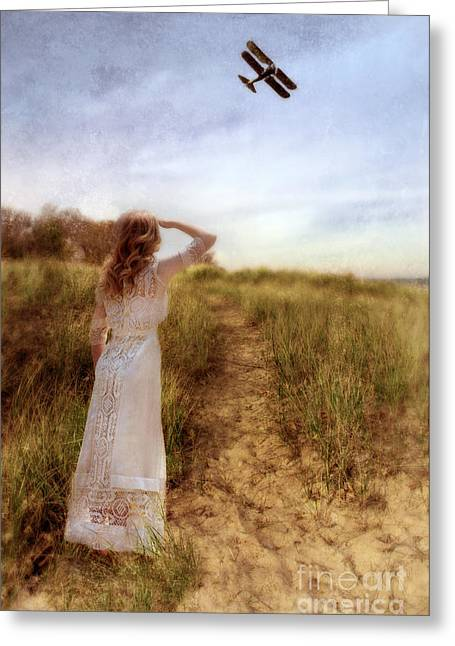 Young Lady In Vintage Clothing Watching A Biplane Greeting Card by Jill Battaglia