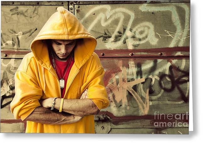 Adolescence Greeting Cards - Young man in hooded sweatshirt on grunge wall Greeting Card by Michal Bednarek