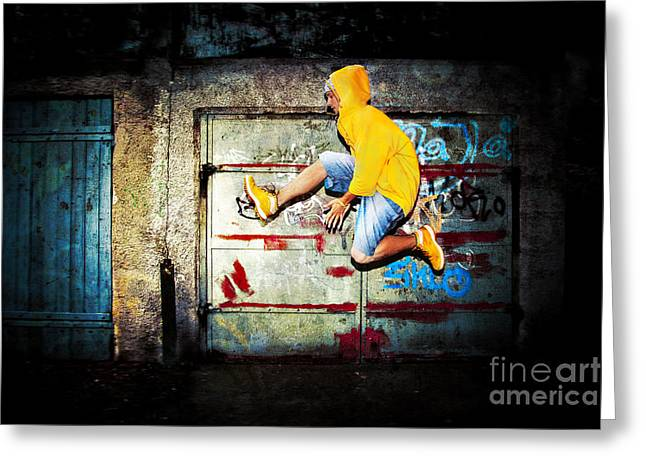 Figure Pose Greeting Cards - Young man jumping on grunge wall Greeting Card by Michal Bednarek