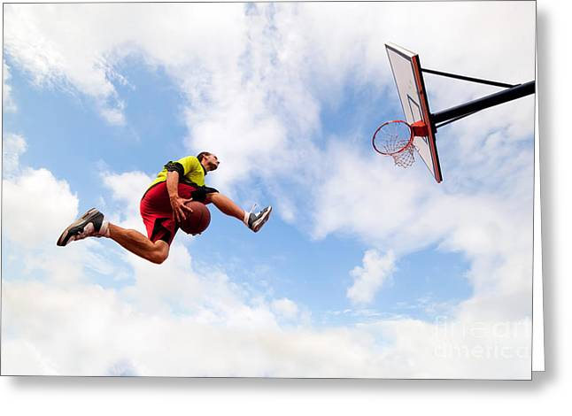 Slam Photographs Greeting Cards - Young man making a fantastic slam dunk playing streetball basketball Greeting Card by Michal Bednarek