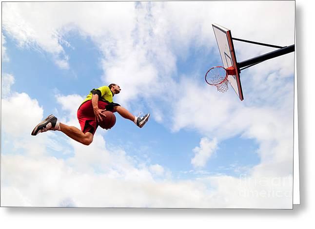 Slamdunk Greeting Cards - Young man making a fantastic slam dunk playing streetball basketball Greeting Card by Michal Bednarek