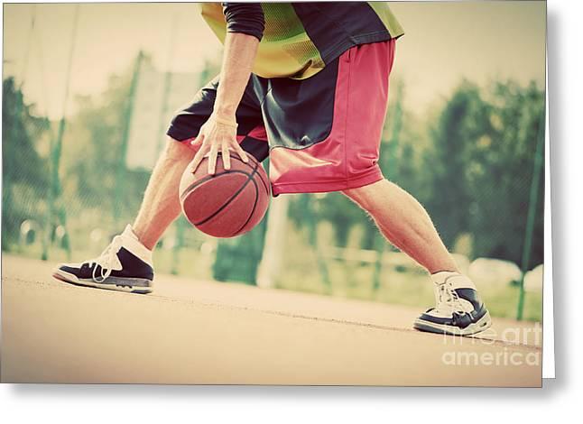 Dribbling Greeting Cards - Young man on basketball court dribbling with ball Greeting Card by Michal Bednarek