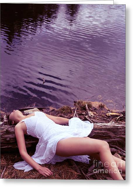 Young Adult Women Greeting Cards - Young woman in white dress lying near lake Greeting Card by Oleksiy Maksymenko